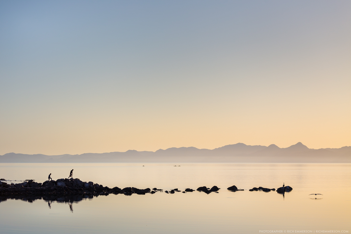 Fishermen on the rocks, Sunrise, Gulf of California near Loreto, Mexico