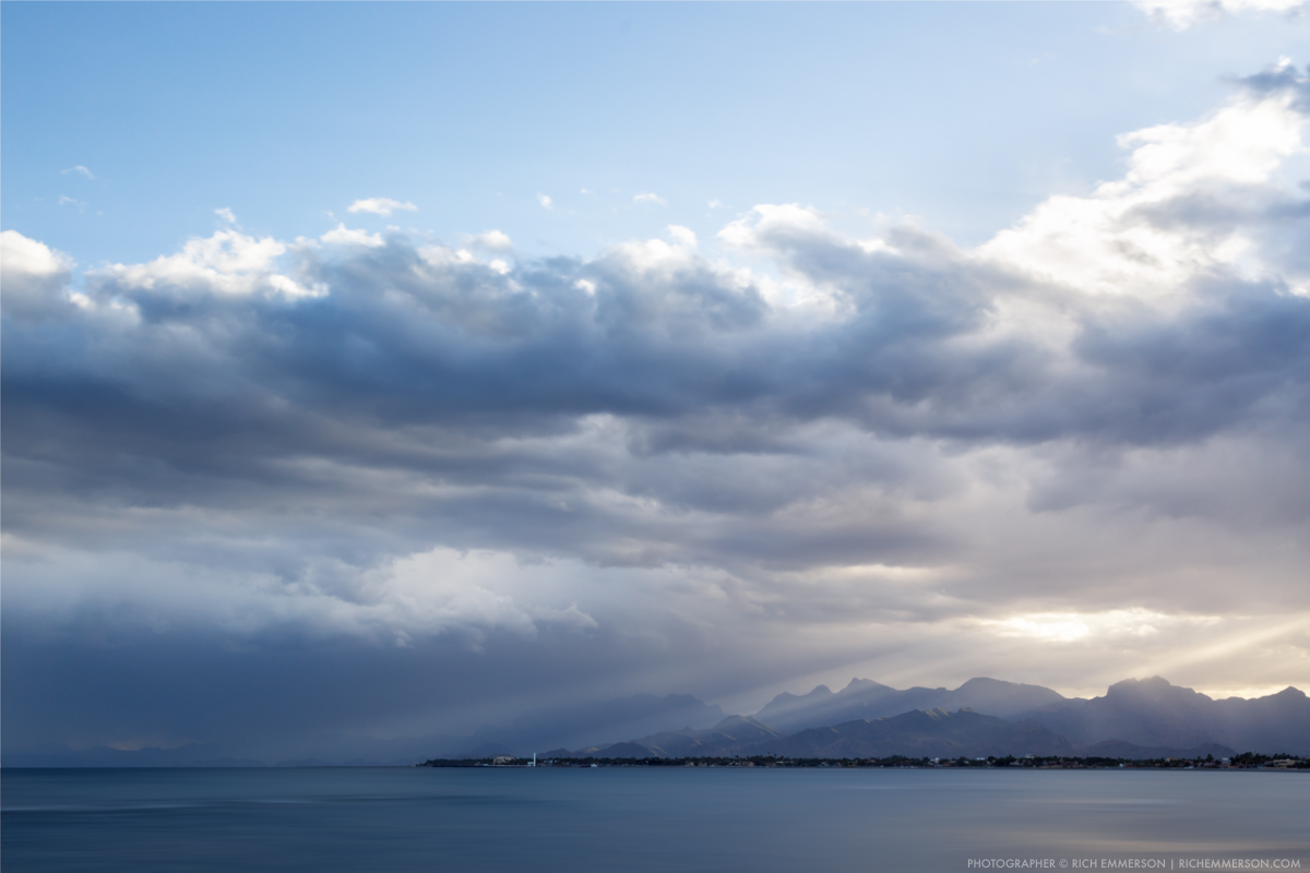 Sun breaks through clouds in Loreto Bay, Mexico