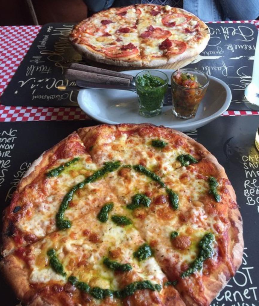 Pizza at Mezzaluna Restaurant Lorteo